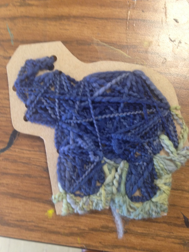 Yarn wrapping over cardboard of an elephant